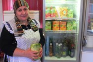 Ingushetia. A woman stands next to a fridge in a cafeteria. The cafeteria belongs to the family of a missing person and the ICRC funded the fridges as part of a microeconomic project.