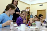 Beslan, North Ossetia. Children enjoy a painting session at the Russian Red Cross psychosocial centre.