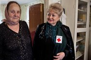Grozny, Chechen Republic, Russian Federation. A beneficiary of the home visits programme with a Russian Red Cross staff member.