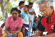 Patients queuing to see the doctor at the mobile health clinic in Maruthankerny