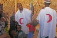 Adado, Galgaduud region, Somalia, 2010. Somali Red Crescent staff weigh children before admitting them and their mothers to the therapeutic feeding centre.