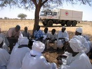 Buram, South Darfur. ICRC delegates talk with community leaders to explain the purpose of their visit and the work of the organization.