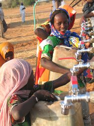 Muglad, Southern Kordofan State, Darfur. Children fetch clean water from ICRC water points.