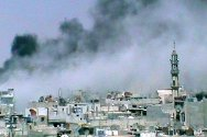 Al Khalidieh near Homs, Syria. Black smoke rises over the city as fighting continues.