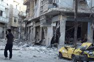 Damaged buildings and car in Khalidiya neighbourhood, Homs.