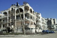 Homs, Syria. Damaged cars and houses in the district of Inshaat.