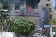 Damascus, 21 July 2012. A house on fire in the suburb of Erbeen.
