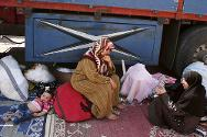 Displaced Syrians at Bab Al-Salam camp, near the border between Syria and Turkey.