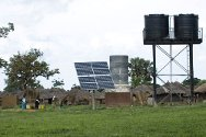 Uganda. Solar panels supply electricity for the pumps that fill water tanks at Arum health centre.