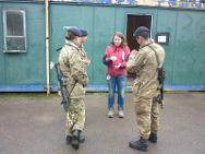An ICRC delegate speaks to an officer cadet during Exercise Broadsword, on a military training area.