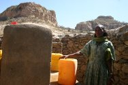 Mezaber, Tigray region, Ethiopia. A woman collects water from a water point installed by the ICRC.