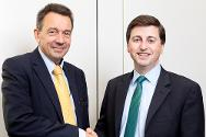 ICRC president Peter Maurer shakes hands with shadow foreign secretary Douglas Alexander at meeting in London.