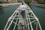 Baghdad, Iraq. An ICRC technician inspects a water pumping station.