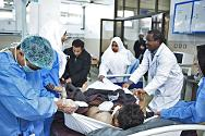 Al Jalaa Hospital, Benghazi, Libya, 27 February 2011. Libyan doctors and nurses treat a patient in the trauma ward.