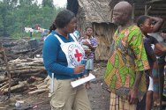 Namasibi, Niger Delta, Nigeria. Maria Olu-Egbuniwe of the ICRC talks to the village chief.