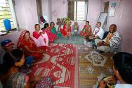 Mahadevpuri-5, Banke district, Nepal. A family support group discusses activities with ICRC staff.