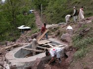 Chinnari. Jehlum valley, Pakistan. ICRC workers build a new water collector at a spring in the mountains above the village.