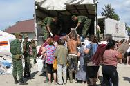 Krasnodar Krai, Krymsk, Russian Federation. EMERCOM staff and army cadets lend a hand at an ICRC aid distribution.