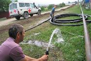 A water engineer tests the recently installed water system.