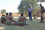 "Zimbabwe. An ICRC instructor briefs officers from the Zimbabwe National Army on an exercise where they will apply skills acquired during an ICRC ""train-the-trainers"" course on humanitarian mine action."
