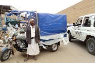 Sa'ada. Ali Ali Mohammed with a three-wheeled vehicle provided by the ICRC in order to help him find a way to make a living.