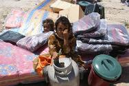 Yemen, Amran governorate, Khaiwan Medina village. Non-food items being distributed to internally displaced people by the ICRC, with the support of the Yemen Red Crescent Society.