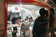 At the Philippine Red Cross basic health-care unit set up inside the stadium, medical staff work round the clock to care for displaced families.