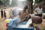 Residents of Mboki using a cassava grinder provided by the ICRC and managed by the community. The grinders make it easier to process this food staple.