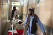Mirwais Hospital, Kandahar, Afghanistan. A child injured by a mortar is brought out of the intensive care unit.