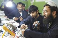 Mirwais Hospital, Kandahar, Afghanistan. Technicians attend a training session in biomedical engineering carried out by an ICRC trainer.