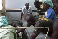 Weapon-wounded are admitted to hospital in Bangui. They were evacuated from the combat zone by the ICRC.