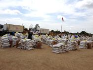 Jebel Marra, Sudan. Staff prepare stacks of food, seed and farming tools for distribution to families from the Jebel Marra region.