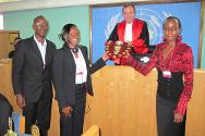Catholic University of Kenya receive the Henry Dunant award from the President of the ICTR.