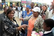 Upon arrival at the airport in South Africa, a jubilant Efodia enquires about her sisters' children and grandchildren.