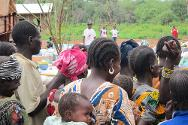 Nana Outa, May 2013. Women line up to receive a month of food rations.
