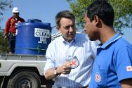 Sittwe, Mynamar. ICRC president Peter Maurer talks to a Myanmar Red Cross worker during a joint ICRC/Myanmar Red Cross water distribution operation at an IDP camp.