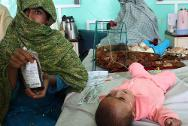 A mother holds a bag of blood for her child at Mirwais Hospital, Afghanistan.