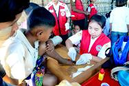 Myanmar, Rakhine State. With the support of the ICRC, the Myanmar Red Cross provides first aid for sick and wounded people from both Muslim and Rakhine communities.