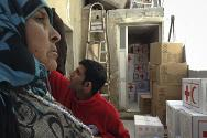 Syria, Rural Aleppo, Syrian Arab Red Crescent branch office. A displaced woman from Al-Raqqa.