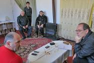 Daniel Khandilyan talks to the ICRC in the family home, renovated with help from the organization.