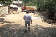 A truck arrives at Chalabi Kishi's home, bearing a consignment of bricks for a protective wall. The assistant from the ICRC's Barda sub-delegation was the first person to enter the yard via the gate.