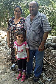 Chalabi Kishi with his wife and grand-daughter. The ICRC has built a wall to protect them from the shooting that continues 20 years after the ceasefire was signed.