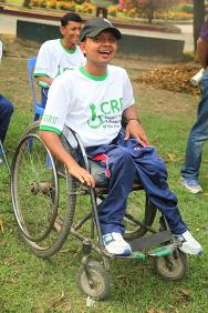 Rubel cheers his teammates from the boundary line. The 25-year-old cricketer works as an occupational therapy assistant at the Centre for Rehabilitation of the Paralysed in Bangladesh.