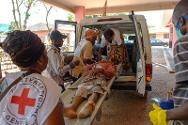 An ICRC medical team evacuates a patient from the Boy-Rabe monastery to bring him to the Bangui community hospital.