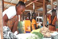 In Yaloké's central market, which is nearly empty, women sell local products such as cassava (manioc) and peanut paste.