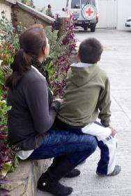 Bogotá, December 2012. Juan, a child victim of weapon contamination, and his mother receive ongoing ICRC support.