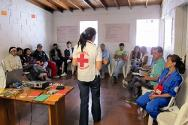 People living on the outskirts of Medellín in communities affected by urban violence are taught how to stay safe and administer first aid.