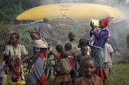Kanyarucinya, North Kivu, DR Congo. A bright yellow ICRC water bladder provides displaced families with clean drinking water.