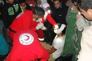 An Egyptian Red Crescent emergency action team providing medical assistance in Cairo.