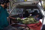 Mirwais hospital, Kandahar, Afghanistan. A taxi arrives with people injured by explosions in their village of Zhari.